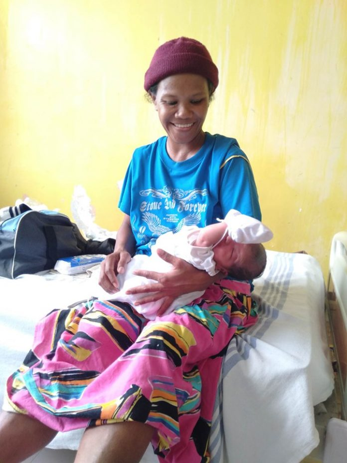 Shirley Obias with her baby