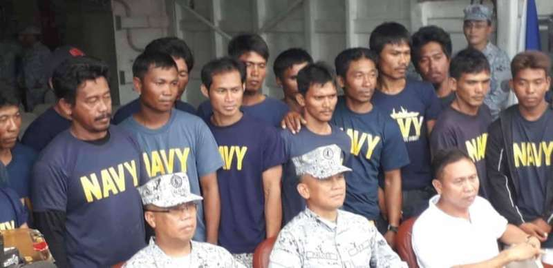 Navy with rescued fishermen