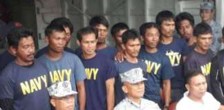 cropped Navy with rescued fishermen