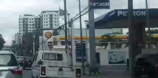 cropped gas station oil price hike petron shell